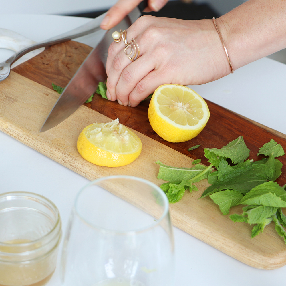 slicing lemon and mint leaves' Blue-Green Algae Lemonade