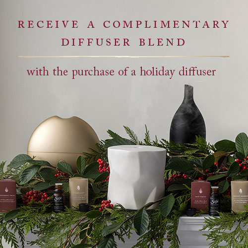 Three holiday diffusers and diffuser blends with holiday greenery - Receive a complimentary diffuser blend with a holiday diffuser