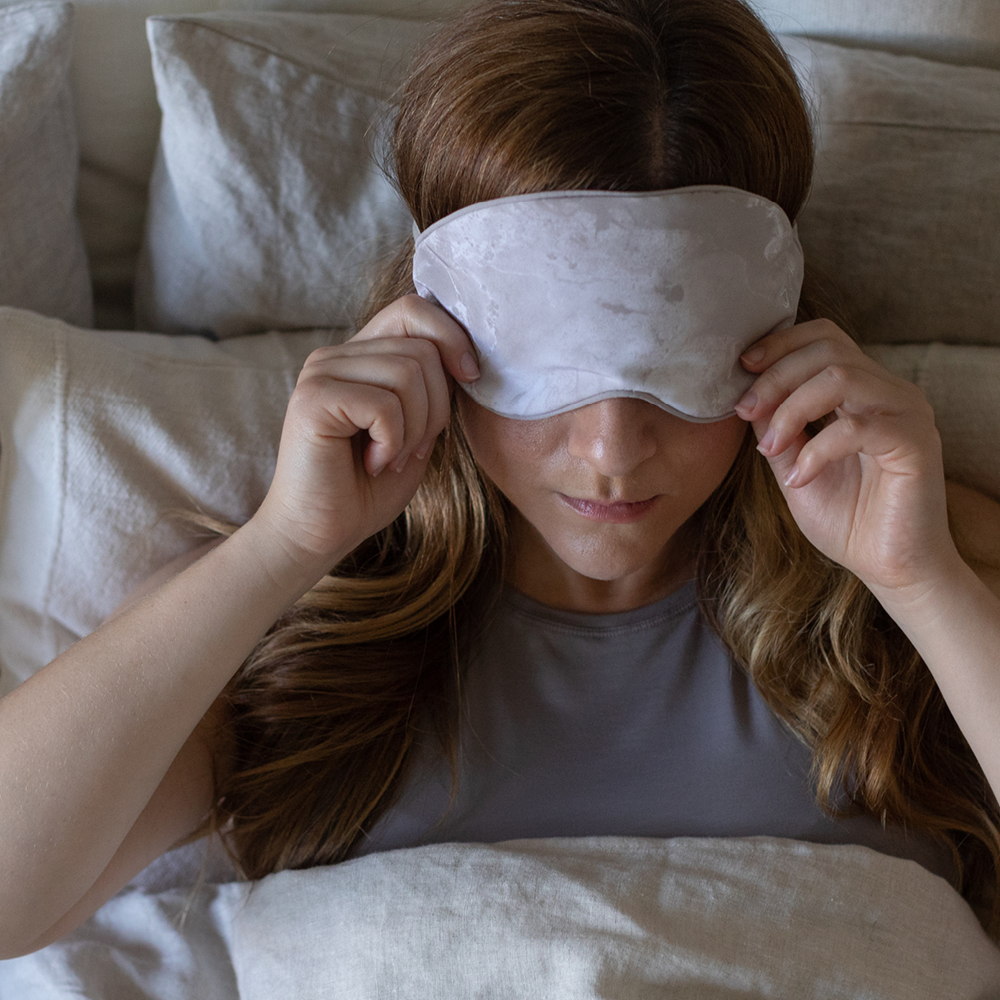 close-up of woman sleeping with eye-mask