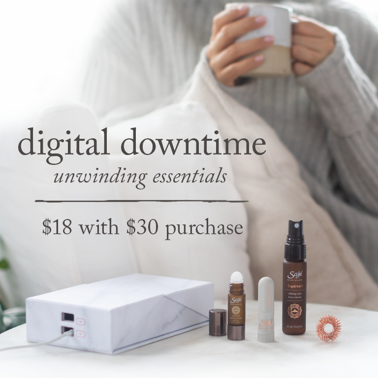 woman sipping from a mug in the background of digital downtime unwinding essentials kit