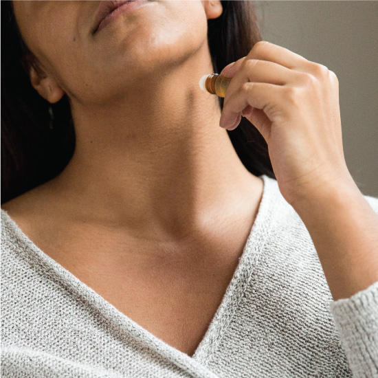 Saje Immune remedy being applied onto the neck